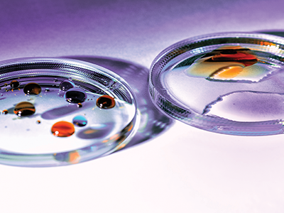 A pair of glass lenses before and after plasma treatment to show improved wettability